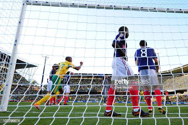 Bernard Parker of South Africa celebrates as Bongani Khumalo of South Africa scores the first goal during the 2010 FIFA World Cup South Africa Group...