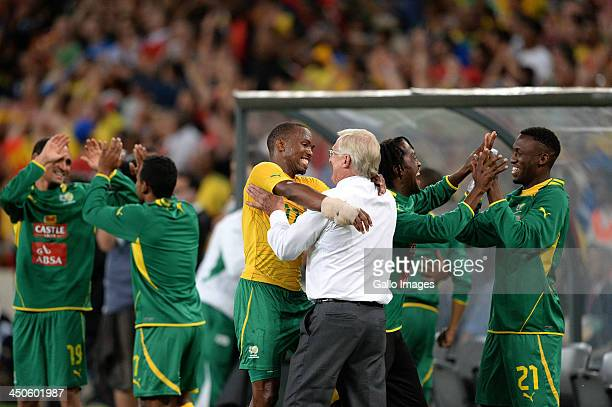 Bernard Parker of South Africa celebrates with manager Gordon Igesund at the final whistle during the International friendly match between South...