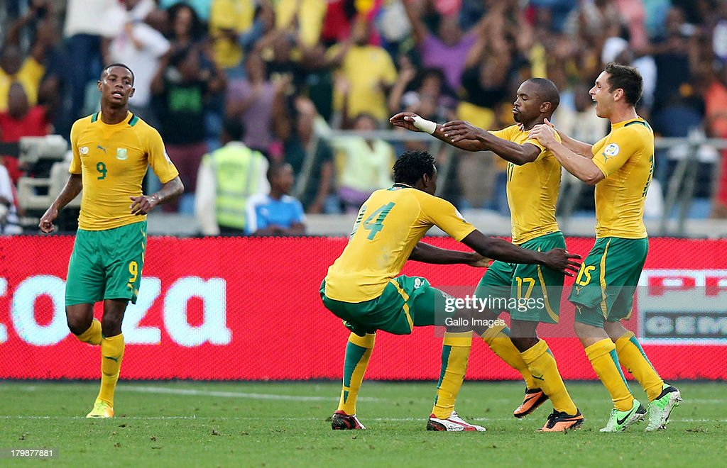 <a gi-track='captionPersonalityLinkClicked' href=/galleries/search?phrase=Bernard+Parker&family=editorial&specificpeople=1003236 ng-click='$event.stopPropagation()'>Bernard Parker</a> of South Africa celebrates with team-mates after scoring a goal during the 2014 FIFA World Cup Qualifier match between South Africa and Botswana from Moses Mabhida Stadium on September 07, 2013 in Durban, South Africa.