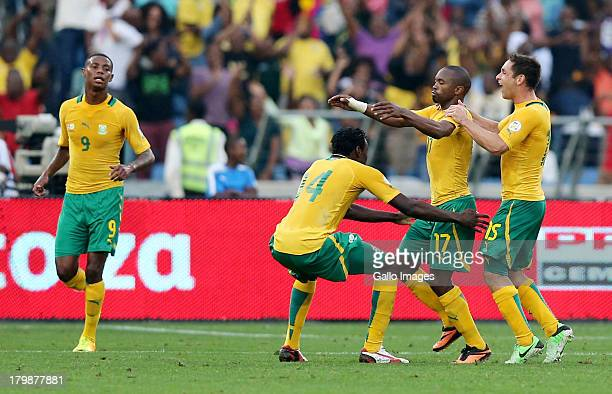 Bernard Parker of South Africa celebrates with teammates after scoring a goal during the 2014 FIFA World Cup Qualifier match between South Africa and...