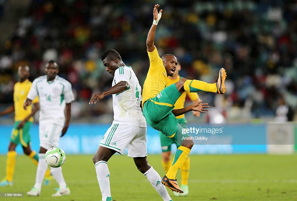 Bernard Parker of South Africa (R) clashes in the air during the 2013 Nelson Mandela Challenge match between South Africa and Nigeria at Moses Mabhida Stadium on August 14, 2013 in Durban, South Africa.