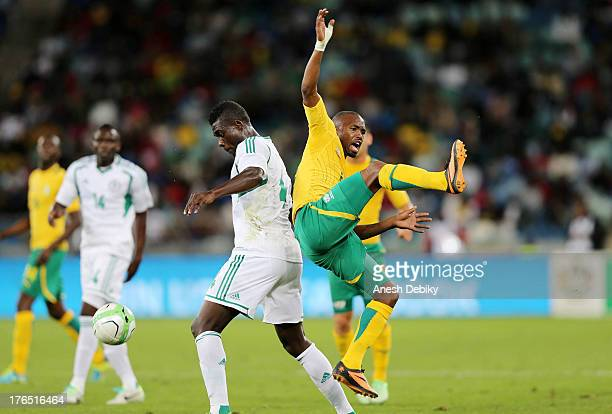 Bernard Parker of South Africa clashes in the air during the 2013 Nelson Mandela Challenge match between South Africa and Nigeria at Moses Mabhida...