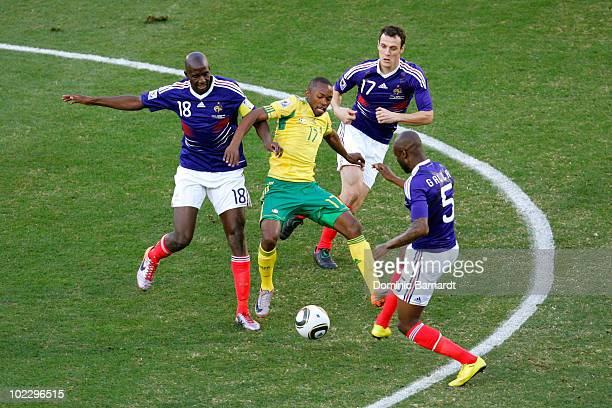 Bernard Parker of South Africa is challenged by Alou Diarra Sebastien Squillaci and William Gallas of France during the 2010 FIFA World Cup South...
