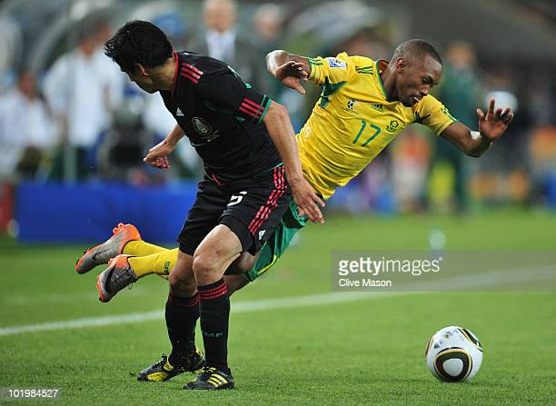 Bernard Parker of South Africa is tackled by Ricardo Osorio of Mexico during the 2010 FIFA World Cup South Africa Group A match between South Africa...