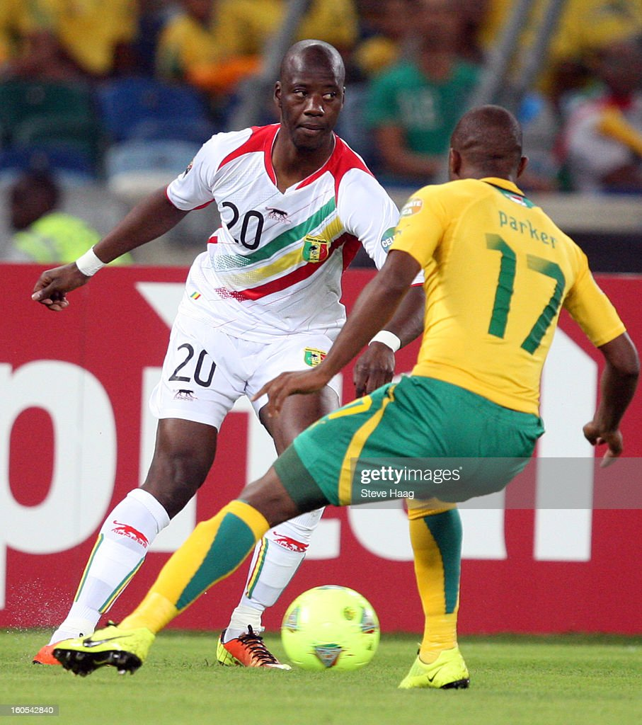 Bernard Parker of South Africa looks to make a tackle on Samba Diakite of Mali during the 2013 African Cup of Nations Quarter-Final match between South Africa and Mali at Moses Mahbida Stadium on February 02, 2013 in Durban, South Africa.