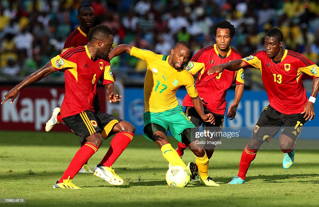 <a gi-track='captionPersonalityLinkClicked' href=/galleries/search?phrase=Bernard+Parker&family=editorial&specificpeople=1003236 ng-click='$event.stopPropagation()'>Bernard Parker</a> of South Africa takes on the Angolan defence during the 2013 African Cup of Nations match between South Africa and Angola from Moses Mabhida Stadium on January 23, 2012 in Durban, South Africa.