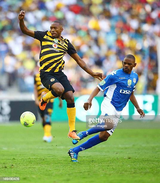 Bernard Parker of the Chiefs competes for the ball with Magogi Gabonamong of United during the Nedbank Cup Final between SuperSport United and Kaizer...