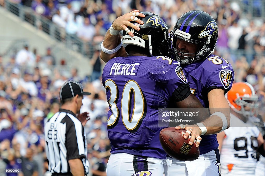 Bernard Pierce #30 of the Baltimore Ravens celebrates with Dallas Clark #87 after scoring a 5-yard touchdown in the third quarter of a game against the Cleveland Browns at M&T Bank Stadium on September 15, 2013 in Baltimore, Maryland.