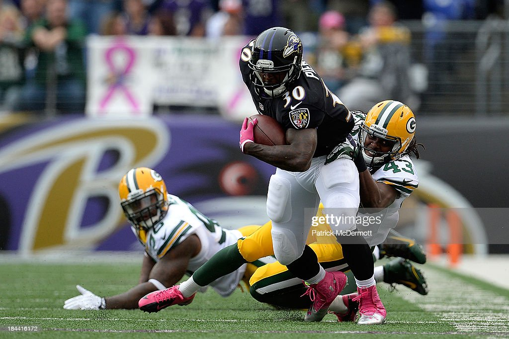 <a gi-track='captionPersonalityLinkClicked' href=/galleries/search?phrase=Bernard+Pierce&family=editorial&specificpeople=6315576 ng-click='$event.stopPropagation()'>Bernard Pierce</a> #30 of the Baltimore Ravens is tackled by <a gi-track='captionPersonalityLinkClicked' href=/galleries/search?phrase=M.D.+Jennings&family=editorial&specificpeople=8047821 ng-click='$event.stopPropagation()'>M.D. Jennings</a> #43 of the Green Bay Packers in the first half during a game at M&T Bank Stadium on October 13, 2013 in Baltimore, Maryland.