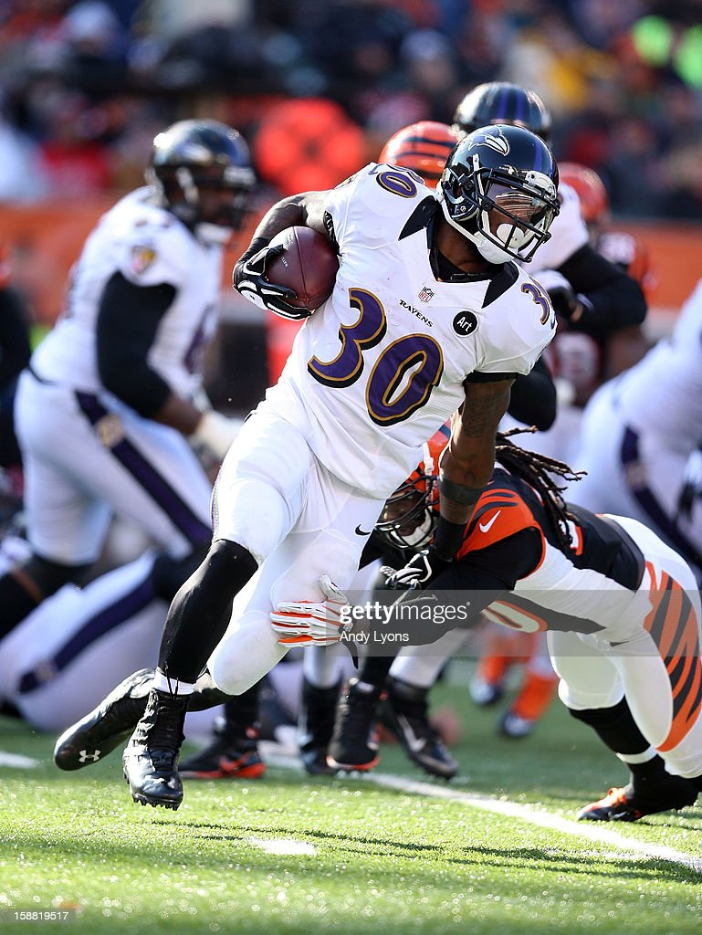 Bernard Pierce #30 of the Baltimore Ravens runs with the ball during the NFL game against the Cincinnati Bengals at Paul Brown Stadium on December 30, 2012 in Cincinnati, Ohio.