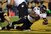 Bernard Pierce of the Baltimore Ravens scores a touchdown in the second quarter against the Pittsburgh Steelers during their AFC Wild Card game at...