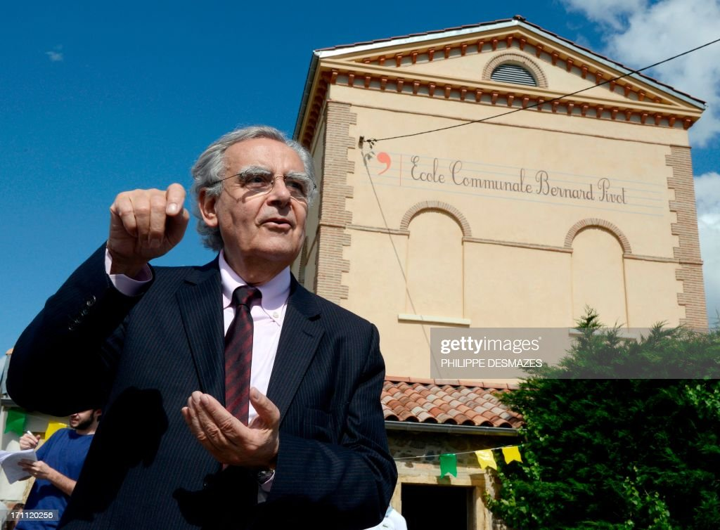 Bernard Pivot, former journalist and member of the academie Goncourt, a French literary organization, poses on June 22, 2013 during the inauguration of the Bernard Pivot school in Vaux-en-Beaujolais, eastern France, the village which inspired the setting for the French satirical novel 'Clochemerle' by Gabriel Chevallier.