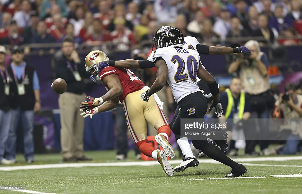 Bernard Pollard #31 and Ed Reed #20 of the Baltimore Ravens break up a pass to Michael Crabtree #15 of the San Francisco 49ers during Super Bowl XLVII at the Mercedes-Benz Superdome on February 3, 2013 in New Orleans, Louisiana. The Ravens won 34-31.