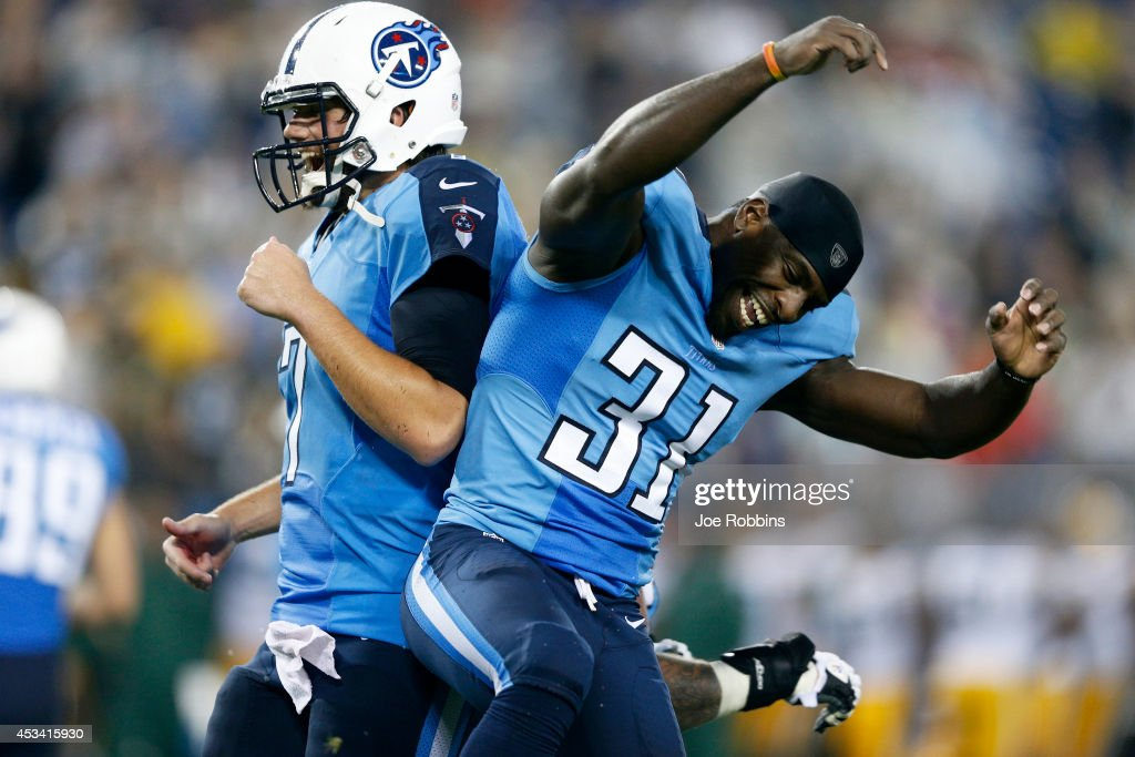 Bernard Pollard #31 and Zach Mettenberger #7 of the Tennessee Titans celebrate after a fourth quarter touchdown run by Jackie Battle during an NFL preseason game against the Green Bay Packers at LP Field on August 9, 2014 in Nashville, Tennessee. The Titans won 20-16.