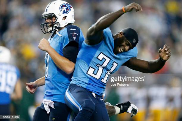 Bernard Pollard and Zach Mettenberger of the Tennessee Titans celebrate after a fourth quarter touchdown run by Jackie Battle during an NFL preseason...