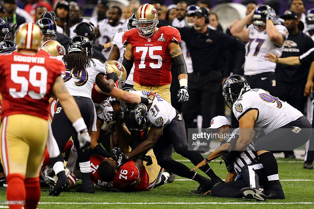 Bernard Pollard #31 of the Baltimore Ravens holds down Anthony Davis #76 of the San Francisco 49ers in a pile up of players as Haloti Ngata #92 of the Ravens attempts to help up referee Jerome Boger #23 during Super Bowl XLVII at the Mercedes-Benz Superdome on February 3, 2013 in New Orleans, Louisiana. The Ravens won 34-31.