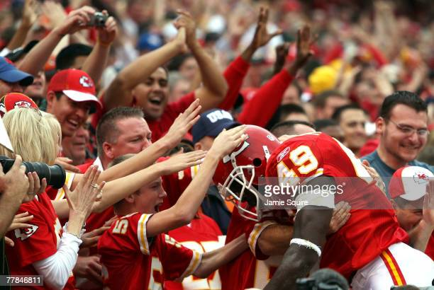 Bernard Pollard of the Kansas City Chiefs jumps into the stands and is congratulated by cheering fans after blocking a punt by kicker Todd Sauerbrun...