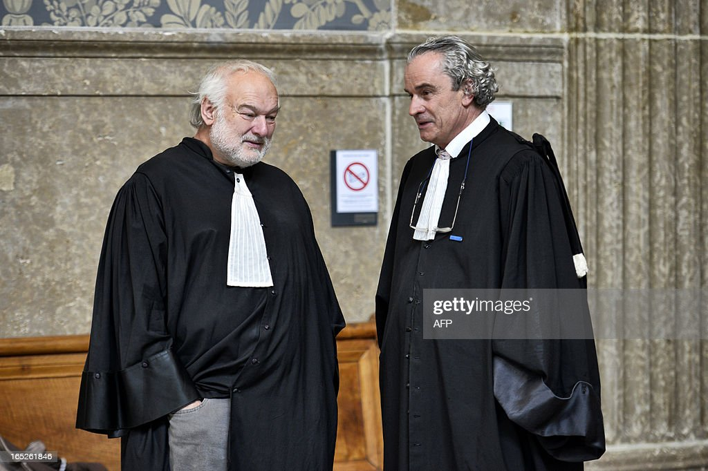 Bernard Ripert (L), counsel for Christophe Khider, discusses with Dominique Jean Lardans, counsel for the plaintiff, in Lyon's criminal courtroom, on April 2, 2013, on the opening day of Christophe Khider and Omar Top El Hadj's trial. They are judged for having escaped from jail using explosives and taking hostages two prison staffs.