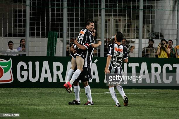 Bernard Ronaldinho and Fillipe Soutto of Atlético celebrate a scored goal during a match between Atlético MG and Figueirense as part of the...