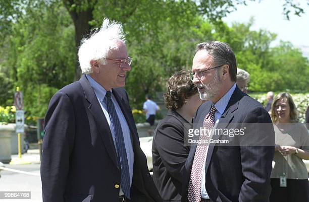 Bernard Sanders IVt and David Bonior DMich talk before the start of a press conference on China and human rights