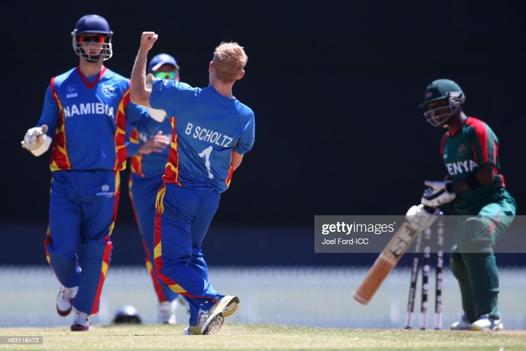 Bernard Scholtz of Namibia celebrates capturing the wicket of Morris Ouma (R) of Kenya during an ICC World Cup qualifying match between Namibia and Kenya on January 17, 2014 in Mount Maunganui, New Zealand.