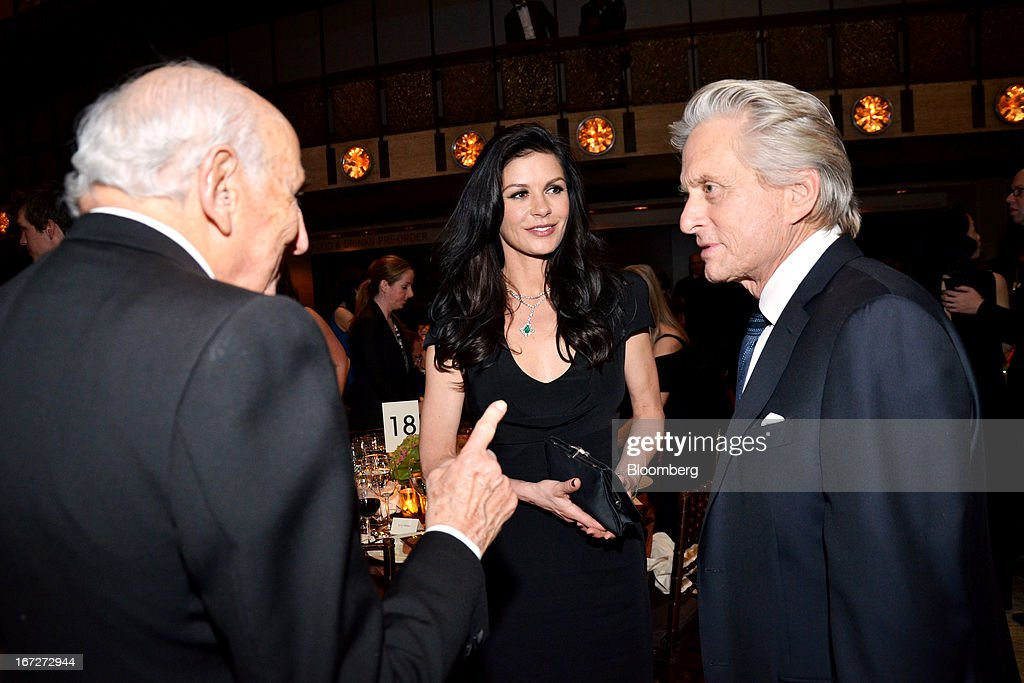 Bernard Schwartz, a funder of the Chaplin Award for 30 years, left, speaks with actors Catherine Zeta-Jones and Michael Douglas at the Film Society of Lincoln Center 40th Anniversary Chaplin Award Gala at Lincoln Center in New York, U.S., on Monday, April 22, 2013. Streisand received the award. Photographer: Amanda Gordon/Bloomberg via Getty Images