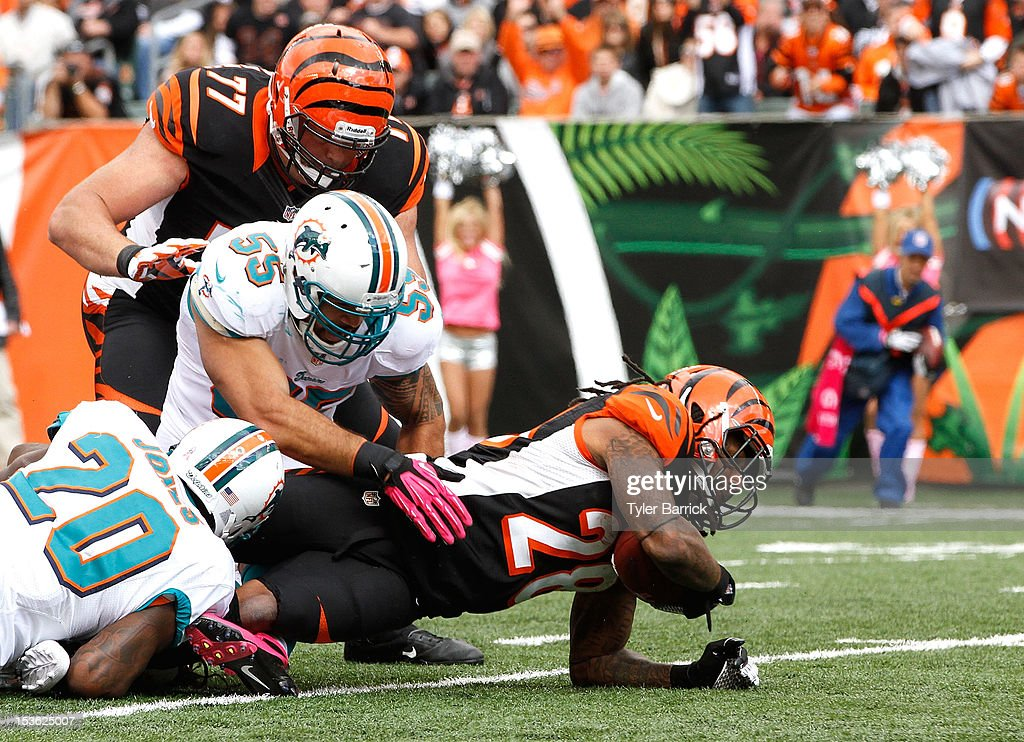 <a gi-track='captionPersonalityLinkClicked' href=/galleries/search?phrase=Bernard+Scott&family=editorial&specificpeople=5734562 ng-click='$event.stopPropagation()'>Bernard Scott</a>, #28 of the Cincinnati Bengals, is tackled by Reshad Jones, #20 and Koa Misi, #55 of the Miami Dolphins at Paul Brown Stadium on October 7, 2012 in Cincinnati, Ohio.