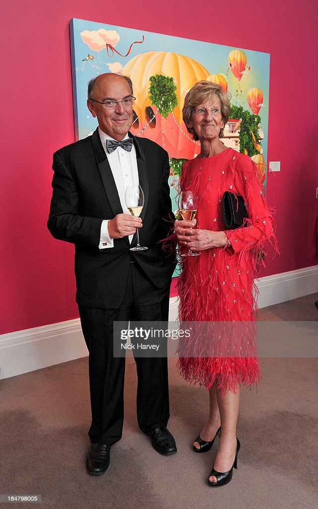 Bernard Soens and Mimi Dusselier attend Mimi Foundation 'The Power of Love' gala dinner and auction at Sotheby's on October 16, 2013 in London, England.