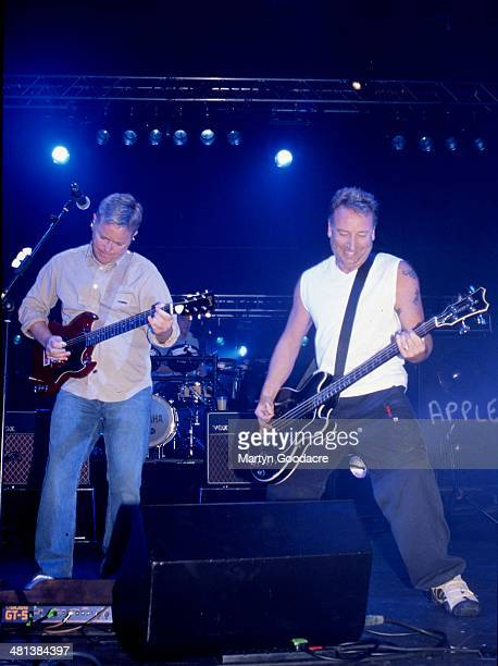 Bernard Sumner and Peter Hook of New Order perform on stage at Brixton Academy London in October 2001