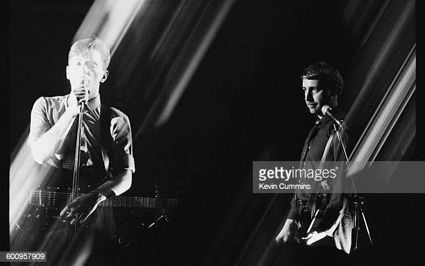 Bernard Sumner and Peter Hook performing with English rock group New Order at Comanche Student Union Manchester Polytechnic 6th February 1981