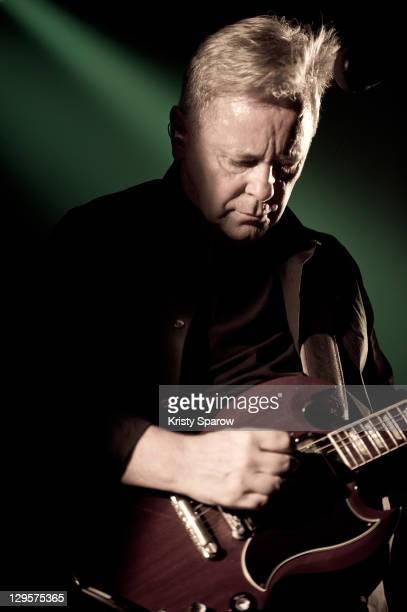 Bernard Sumner of New Order performs on stage at Le Bataclan on October 18 2011 in Paris France