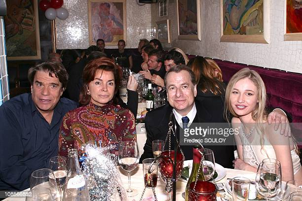 Bernard Tapie and wife Dominique with PaulLoup Sulitzer and Eva Kowalewska in Paris France on October 21st 2004