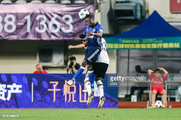 Bernard Tekpetey of FC Schalke 04 and Cenk Tosun of Besiktas comepte for the ball during the 2017 International soccer match between Schalke 04 and...