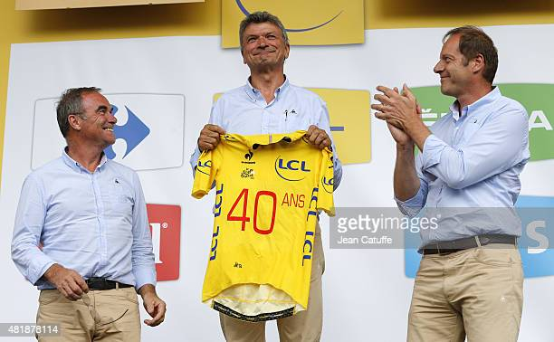 Bernard Thevenet receives from Bernard Hinault and Director of Tour de France Christian Prudhomme a special yellow jersey celebrating the 40th...
