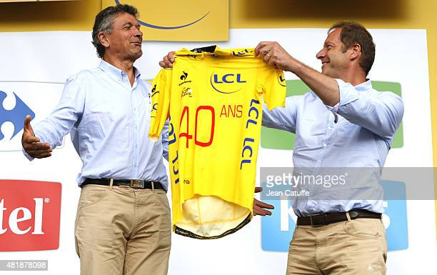 Bernard Thevenet receives from Director of Tour de France Christian Prudhomme a special yellow jersey celebrating the 40th anniversary of his victory...