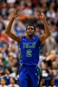 Bernard Thompson of the Florida Gulf Coast Eagles reacts after he made a 3point basket in the first half against the Georgetown Hoyas during the...