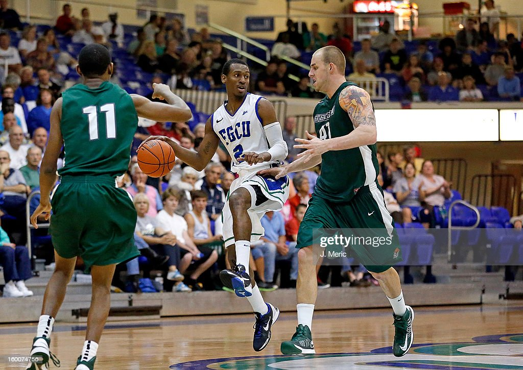 Bernard Thompson #2 of the Florida Gulf Coast University Eagles drives to the basket as Adam Pegg #41 of the Stetson Hatters defends during the game at Alico Arena on January 25, 2013 in Ft. Myers, Florida.