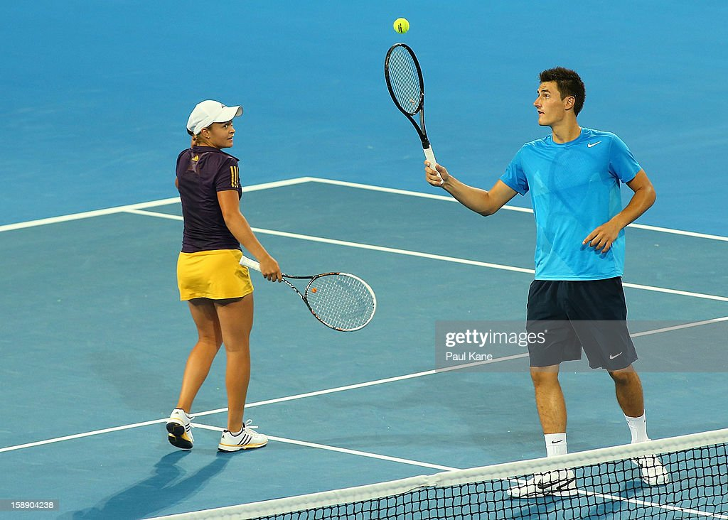 Bernard Tomic and Ashleigh Barty of Australia contest the mixed doubles match against Francesca Schiavone and Andreas Seppi of Italy during day six of the Hopman Cup at Perth Arena on January 3, 2013 in Perth, Australia.