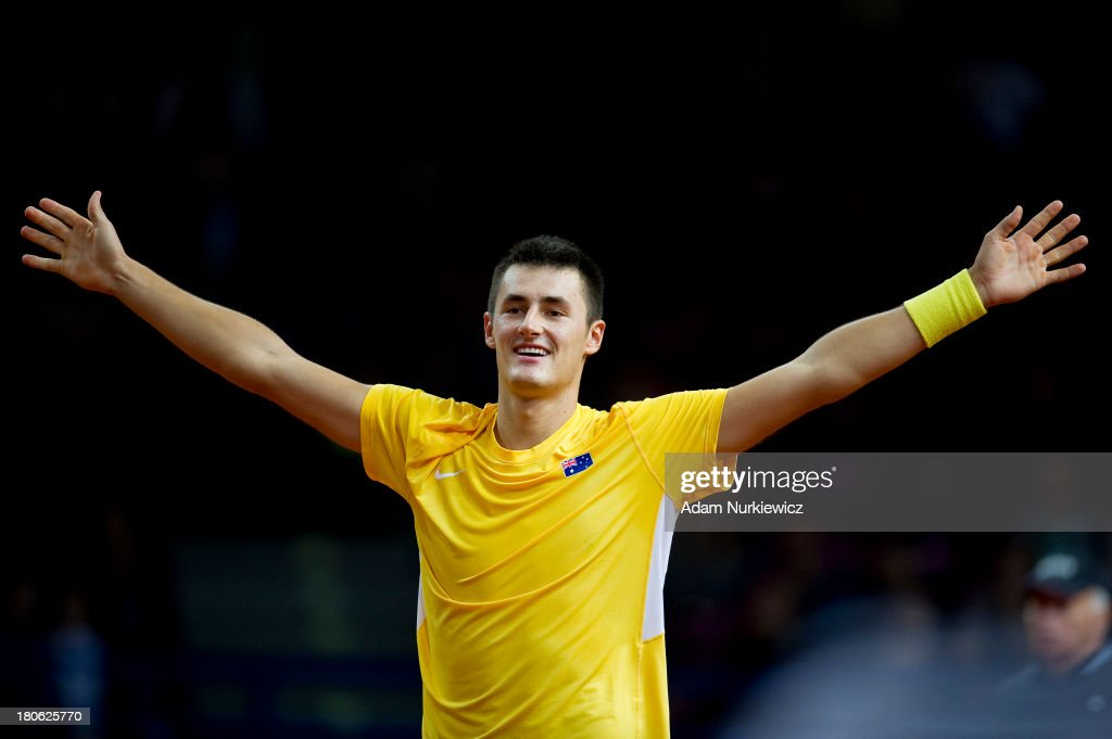 Bernard Tomic from Australia celebrates his winning game and victory in the Davis Cup match between Poland and Australia at the Torwar Hall, on September 15, 2013 in Warsaw, Poland.