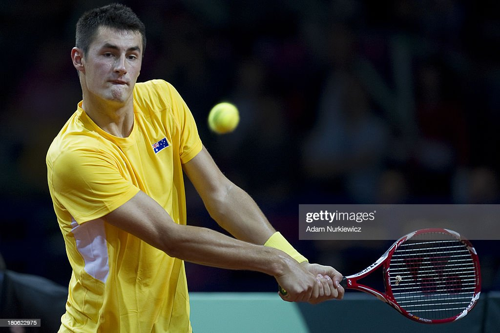 Bernard Tomic from Australia in action during the Davis Cup match between Poland and Australia at the Torwar Hall, on September 15, 2013 in Warsaw, Poland.