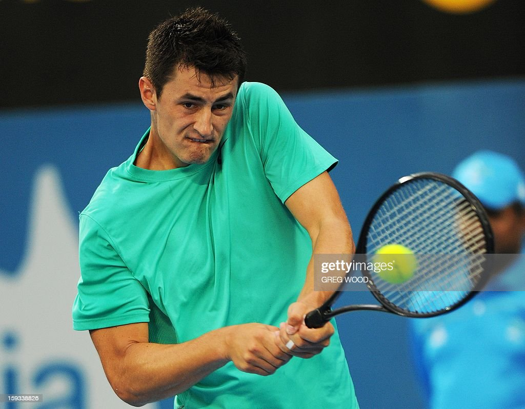 Bernard Tomic from Australia plays a backhand return to Kevin Anderson of South Africa during the men's final at the Sydney International tennis event on January 12, 2013. IMAGE STRICTLY RESTRICTED TO EDITORIAL USE - STRICTLY NO COMMERCIAL USE AFP PHOTO / Greg WOOD