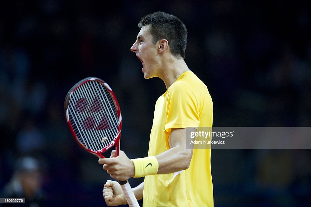 Bernard Tomic from Australia reacts after winning second set during the Davis Cup match between Poland and Australia at the Torwar Hall, on September 15, 2013 in Warsaw, Poland.