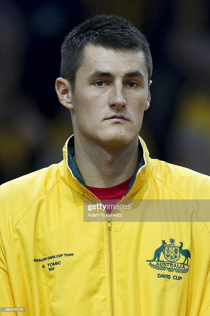 Bernard Tomic from Australia while national anthem before the Davis Cup match between Poland and Australia at the Torwar Hall, on September 13, 2013 in Warsaw, England.