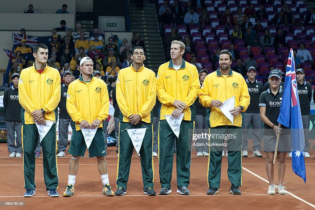Bernard Tomic, Lleyton Hewitt, Nick Kyrgios, Chris Guccione and Patrick Rafter - captain of Australia team stand suring the national anthem before the Davis Cup match between Poland and Australia at the Torwar Hall, on September 13, 2013 in Warsaw, England.