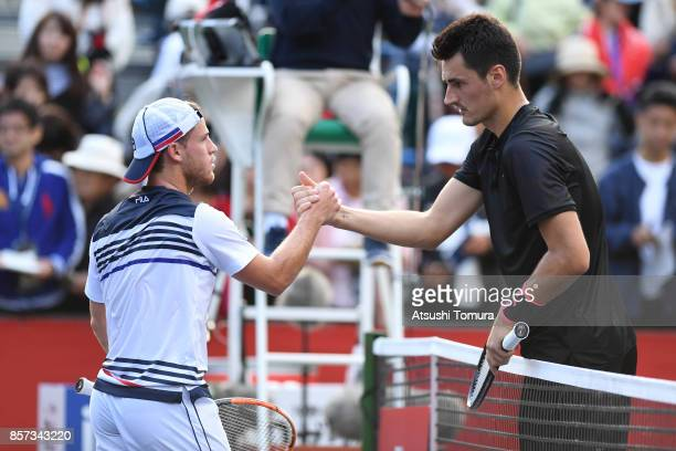 Bernard Tomic of Australia and Diego Schwartzman of Argentina shake hand after their match during day three of the Rakuten Open at Ariake Coliseum on...