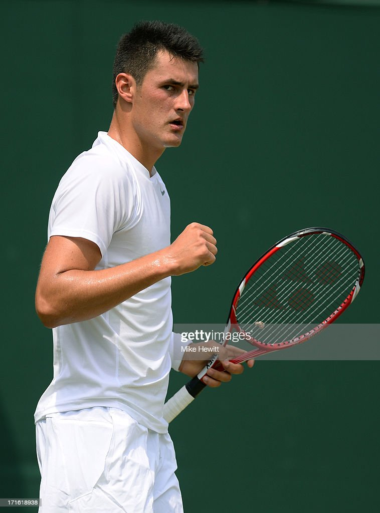 Bernard Tomic of Australia celebrates a point during his Gentlemen's Singles second round match against James Blake of the United States of America on day four of the Wimbledon Lawn Tennis Championships at the All England Lawn Tennis and Croquet Club on June 27, 2013 in London, England.