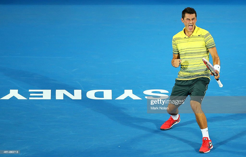 <a gi-track='captionPersonalityLinkClicked' href=/galleries/search?phrase=Bernard+Tomic&family=editorial&specificpeople=650713 ng-click='$event.stopPropagation()'>Bernard Tomic</a> of Australia celebrates a point in his match against Alexandr Dolgopolov of the Ukraine during day five of the 2014 Sydney International at Sydney Olympic Park Tennis Centre on January 9, 2014 in Sydney, Australia.