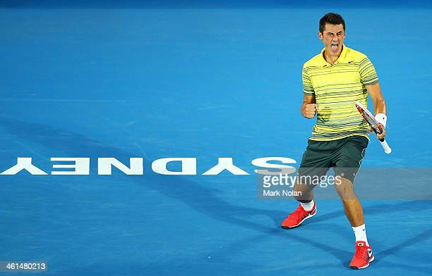 Bernard Tomic of Australia celebrates a point in his match against Alexandr Dolgopolov of the Ukraine during day five of the 2014 Sydney...