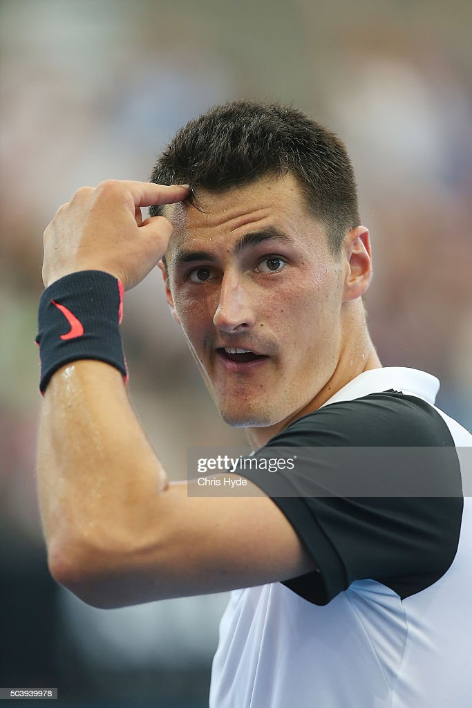 Bernard Tomic of Australia celebrates a point in his quarter final matach against Kei Nishikori of Japan during day six of the 2016 Brisbane...
