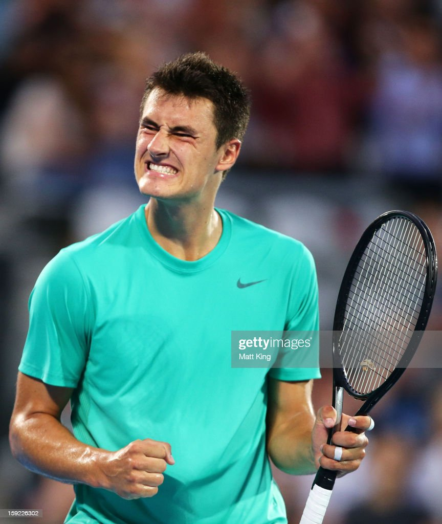 <a gi-track='captionPersonalityLinkClicked' href=/galleries/search?phrase=Bernard+Tomic&family=editorial&specificpeople=650713 ng-click='$event.stopPropagation()'>Bernard Tomic</a> of Australia celebrates breaking serve in his quarter final match against Jarkko Nieminen of Finlan during day five of the Sydney International at Sydney Olympic Park Tennis Centre on January 10, 2013 in Sydney, Australia.